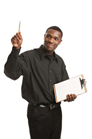 Young Black Man Holding Clipboard Pointing, Smiling Isolated on White Background photo