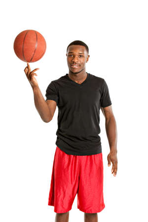 finger tip: Young Black College Student Playing Basket Ball on Isolated White Background