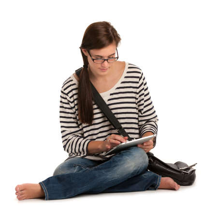 Casual Dressed High School Student Reading Holding Touch Pad PC on Isolated Background Stock Photo - 11096964