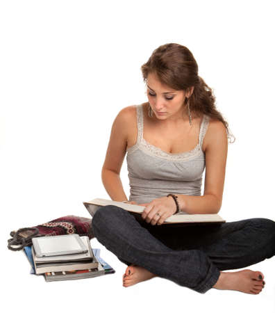 Casual Dressed Young Female College Student Reading Book Isolated on White Background photo