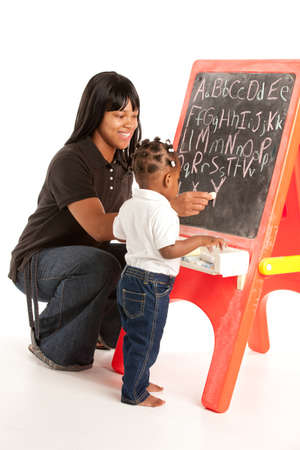 mother board: 3 Year Old African American Girl and Mom Standing in font of Blackboard Stock Photo