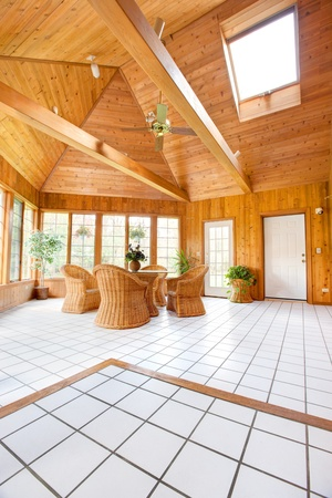 sunroom: Wooden Wall Sun Room Interior with Natural Wicker Furniture, Ceramic  Tile floor