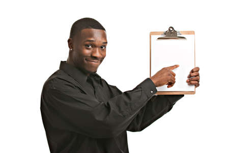 demonstrates: Friendly young black businessman holding clipboard on isolated white background