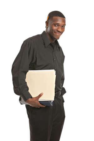 Friendly young black businessman holding binders on isolated white background photo