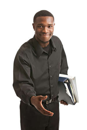 welcome sign: Friendly young black businessman holding binders reach out arm on isolated white background