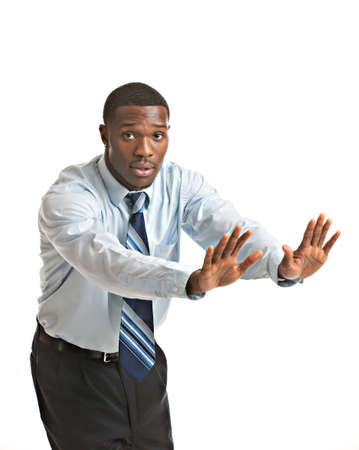 stop gesture: Natural Looking Worried Young African American Businessman on Isolated Background