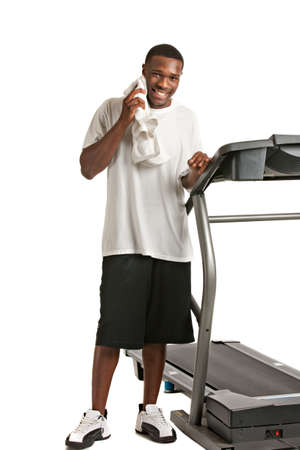 Healthy Young African American Get Ready by Treadmill Isolated on White Background Stock Photo - 12274157