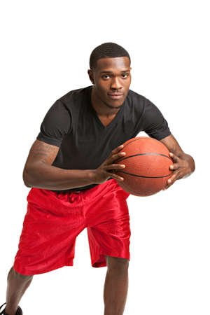 Young Black College Student Playing Basket Ball on Isolated White Background photo