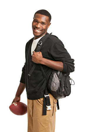 black student: Casual Dressed Happy College Black Student Holding Football Isolated on White Background