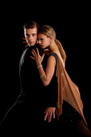 ballroom dance: Ballroom Dancer Pair Dance Low Key on Black Background