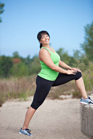overweight: Plus Size Female Exercise Stretch Outdoor Under Sunny Blue Sky