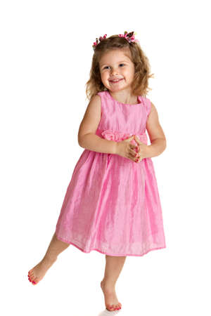 little girl dancing: 3 year old little girl with pink dress dance pose happy portrait on white background