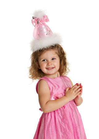 3 year old birthday girl with pink dress and hat isolated on white background photo