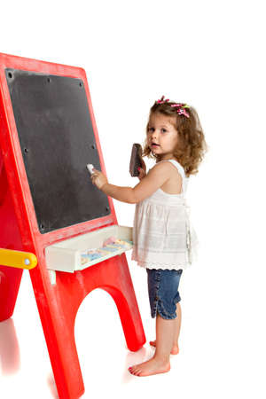 Little Preschool Girl Writing on Blackboard on Isolated White Background Stock Photo - 13310715
