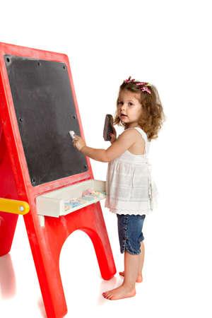 Little Preschool Girl Writing on Blackboard on Isolated White Background Stock Photo - 13310715