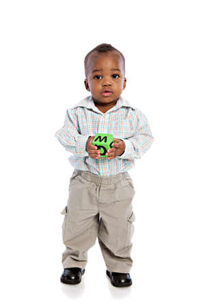 1 year old: 1 year old baby boy standing holding a soft toy ball on isolated background