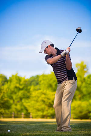golf swings: Young Golfer Swing Club under Summer Blue Sky Stock Photo