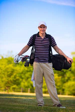 golf stick: Young Golfer Swing Club under Summer Blue Sky Stock Photo