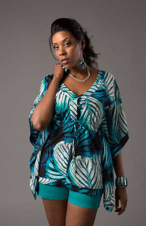 Plus Size Young African American   Woman Standing Portrait on Grey Background photo
