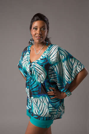 full size: Plus Size Young African American   Woman Standing Portrait on Grey Background