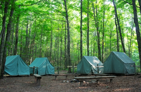 Wall Style Camping Tents at Rustic Campground during Daytime in Woods Stock Photo - 14481365