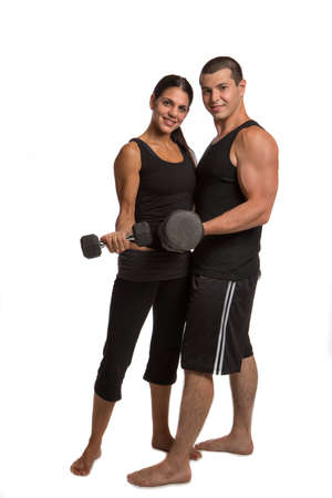 Young Fitness Couple Lifting Weights Isolated on White photo