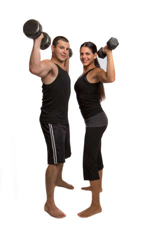 Young Fitness Couple Lifting Weights Isolated on White Stock Photo - 14566812