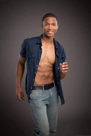Casual Dressed Young African American Male Model Natural Looking on Grey Background photo
