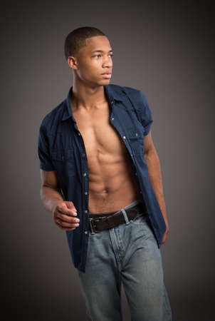 Casual Dressed Young African American Male Model Natural Looking on Grey Background Stock Photo - 14566583