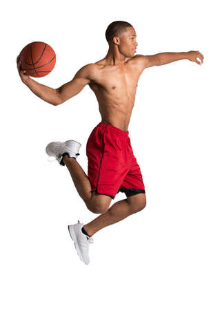 Young Black College Student Jump Slam Dunk Basket Ball on Isolated White Background photo