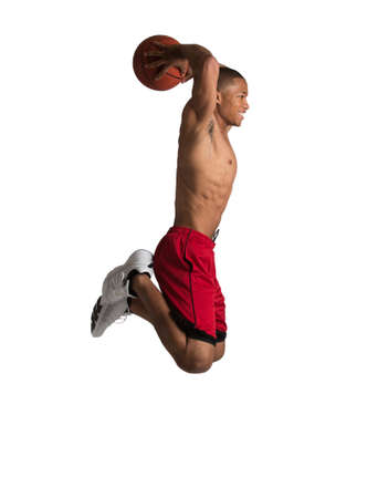 dunk: Young Black College Student Jump Slam Dunk Basket Ball on Isolated White Background