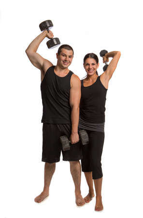 Young Healthy Looking Couple Lifting Weights Isolated on White photo