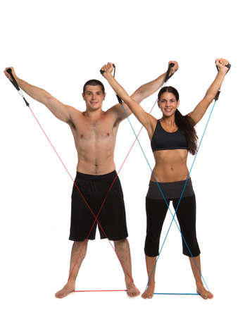 Young Healthy Looking Fit Couple Workout  Together Isolated on White Background Stock Photo - 14626486