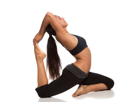 Long Hair Flexible Female Practicing Yoga on Isolated White background photo