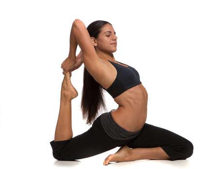 Long Hair Flexible Female Practicing Yoga on Isolated White background photo