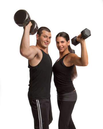 Young Healthy Looking Couple Lifting Weights Isolated on White Stock Photo - 14695284