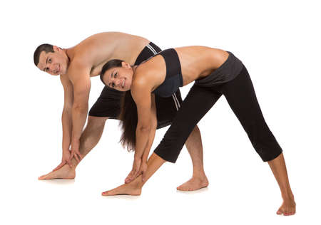 Young Healthy Looking Fit Couple Workout  Together Isolated on White Background photo