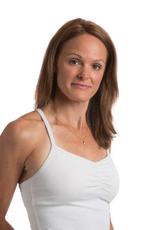 middle age women: Mid Age Natural Looking Female Headshot with Smiling Expression Stock Photo
