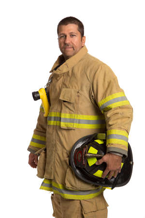 Serious looking confident firefighter standing portrait isolated on white photo