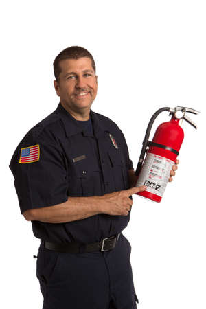 Firefighter in uniform holding fire extinguisher pointing to instruction on isolated white background photo