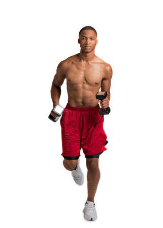 ropa deportiva: Joven africano americano Runner Peso Holding cubierta aislada en el fondo blanco Foto de archivo