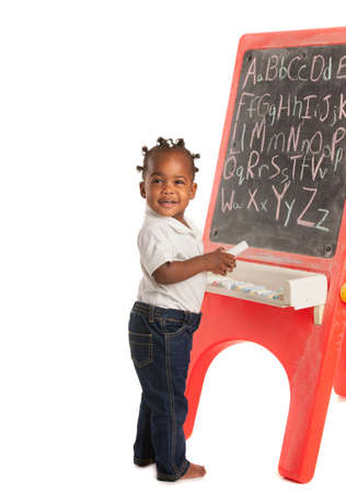 chalk board background: 3 Year Old African American Girl Standing in font of Blackboard on Isolated White Background