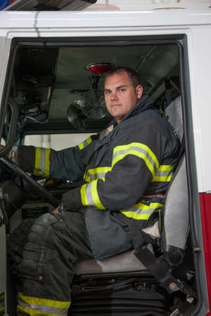 Fireman Driver in Fire Truck Front Seat Stock Photo - 14902917