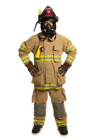 departamentos: Bombero con la m�scara y el traje de protecci�n total sobre fondo blanco aislado Foto de archivo