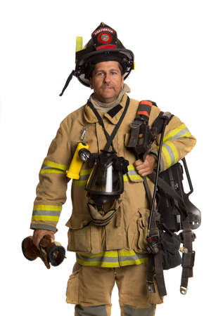 Firefighter holding mask and airpack fully protective suit on isolated white background photo