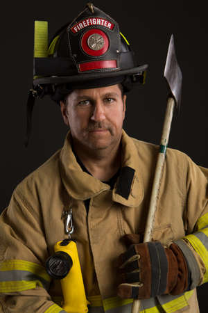 Serious looking confident firefighter Headshot Portrait on Dark Background photo