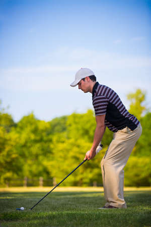 Young Golfer Swing Club under Summer Blue Sky Stock Photo - 15201640