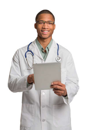 young doctor: African American Doctor Holding Touch-Pad Tablet PC Texting on Isolated White Background Stock Photo