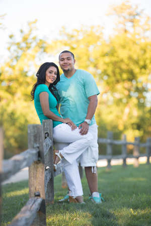 Young Hispanic Couple Engagement  Countryside Picture Outdoor Portrait Summer Morning photo