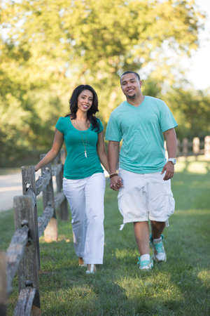 Young Hispanic Couple Engagement Walking at Countryside Picture Outdoor Portrait photo